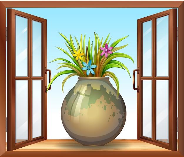 Цветок в вазе возле окна