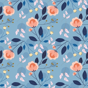 Flower and leaves on blue background seamless pattern