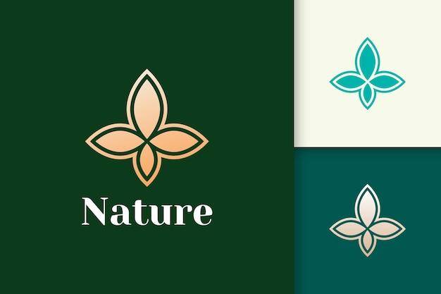 健康と美容のためのシンプルで豪華な葉の形の花のロゴ