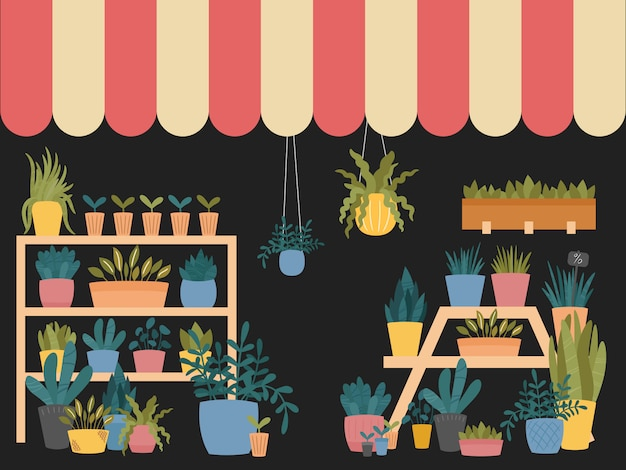 鉢、プランター、ボックスにさまざまな屋内植物があり、棚やスタンドの上に縞模様の小屋が立っているフラワーショップのインテリア。