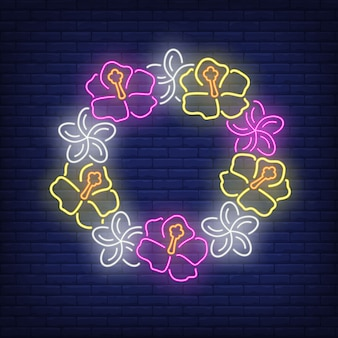 Flower wreath neon sign. circle of pink and yellow hibiscuses.
