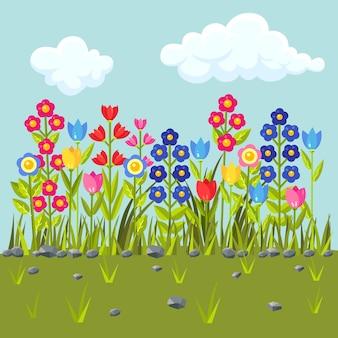 色とりどりの花が咲く花畑。緑の草の境界線。春のシーン