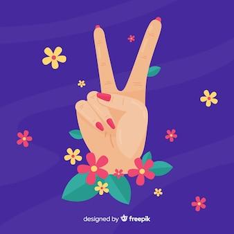 Priorità bassa del segno di pace della mano dei fiori