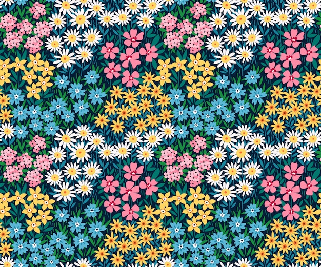 Flowers pattern with small colorful flowers on a dark blue background. ditsy style. vintage floral background. seamless vector pattern for design and fashion prints.