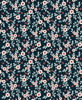 濃い青に小さな白い花を持つ花模様。頭が変なスタイル。ヴィンテージの花の背景。デザインとファッションのプリントのシームレスなパターン。