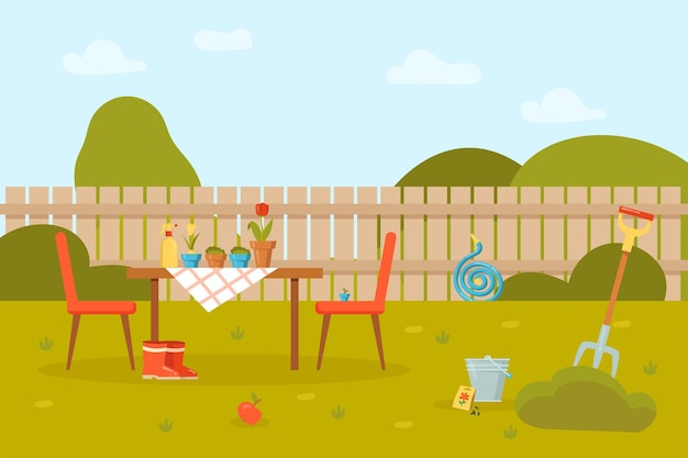 Flowers in pots on table and chairs in garden with fence.