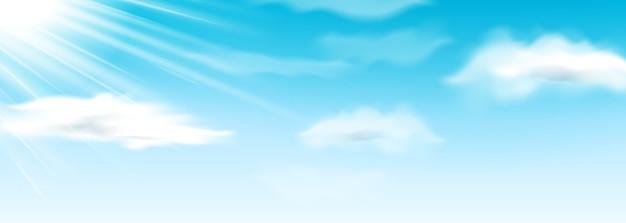 太陽の光と青い空にふわふわの雲。夏または春に太陽と空気。