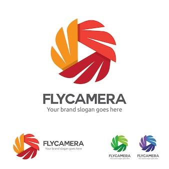 フライカメラロゴ、ウィングと再生ボタンシンボル付きカメラ