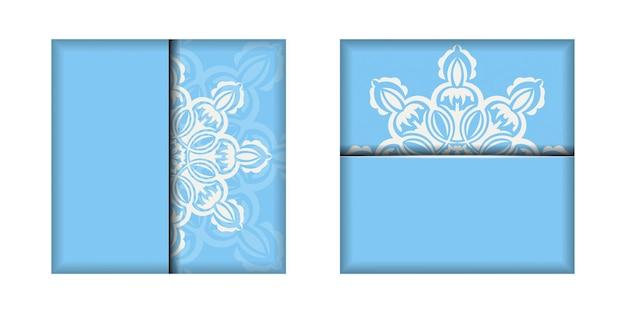 おめでとうございます。白い模様の曼荼羅と青い色のチラシ。
