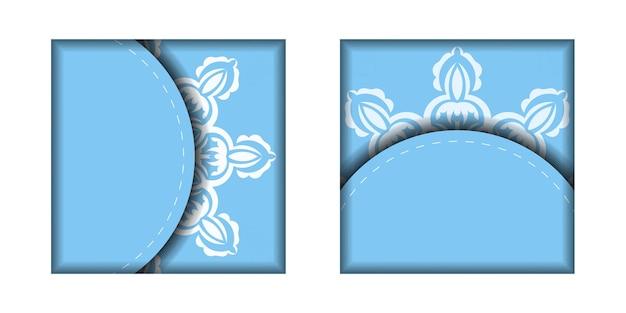あなたのデザインのための曼荼羅の白いパターンと青い色のチラシ。