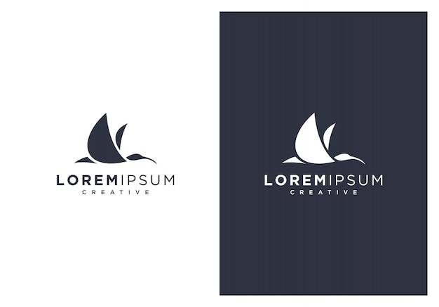 Flying bird silhouette logo version