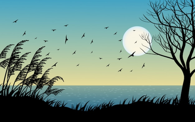 Flying birds sunset landscape with tree and grass