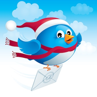 Flying blue bird in the hat santa delivers e-mail