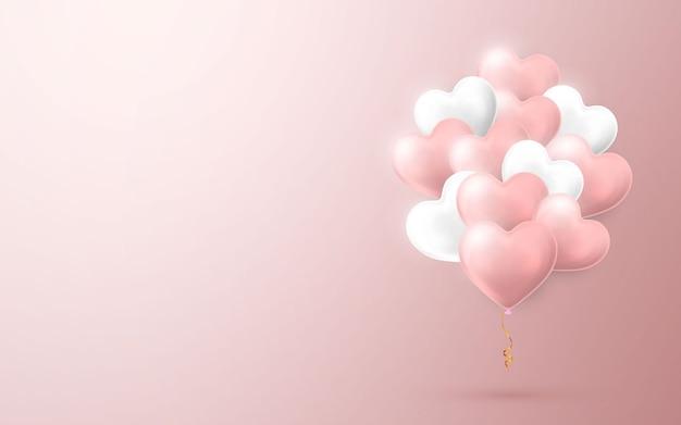 ハートの形で飛んでいるヘリウム気球の束