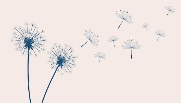 Flying dandelion flowers on beige