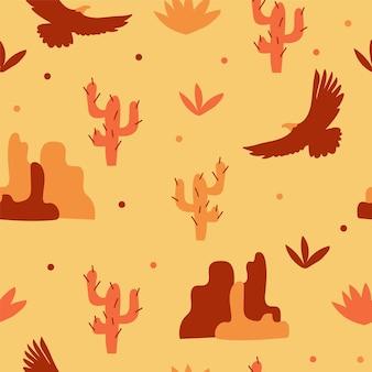 砂漠で飛ぶワシ、山、サボテン。オレンジと黄色のシームレスなパターン