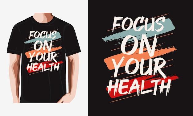 あなたの健康タイポグラフィtシャツのデザインに焦点を当てるプレミアムベクトル