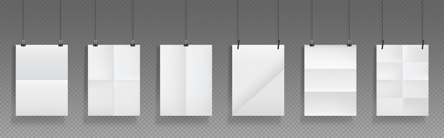 Folded blank posters hang with binder clips, white paper sheets with crossing creases and holders.