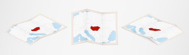 Folded map of hungary in three different versions.