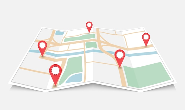 Folded paper city map with red pin pointer