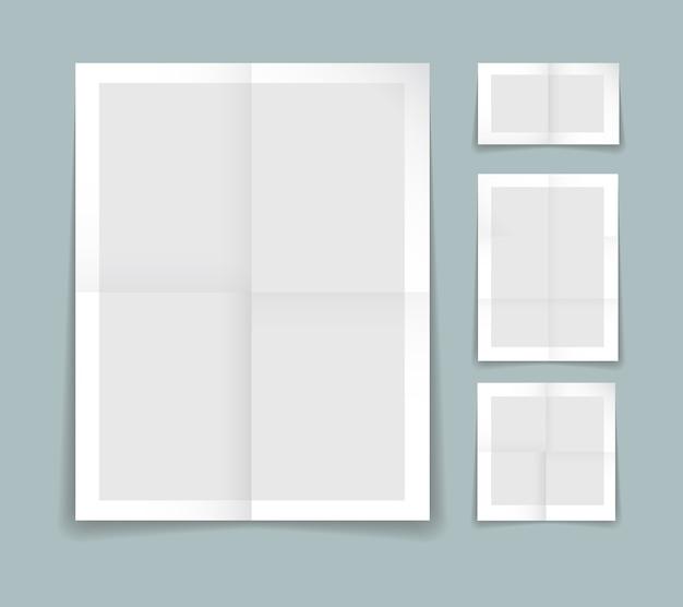 白い境界線を持つ灰色の紙の4つの異なるシートで折り畳まれた紙テンプレート