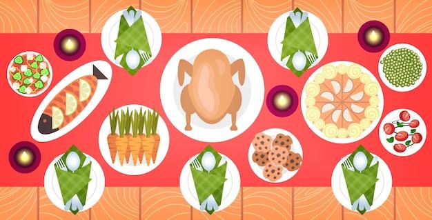 저녁 식사 테이블에 크리스마스 또는 새 해 메뉴에 음식 오리 구이와 반찬 겨울 휴가 축 하 개념 위쪽 각도보기 그림