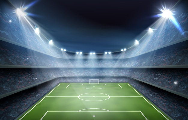 Football arena field or soccer stadium background with bright spotlights