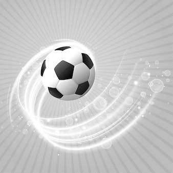 白い光の軌跡と輝きとサッカーの背景