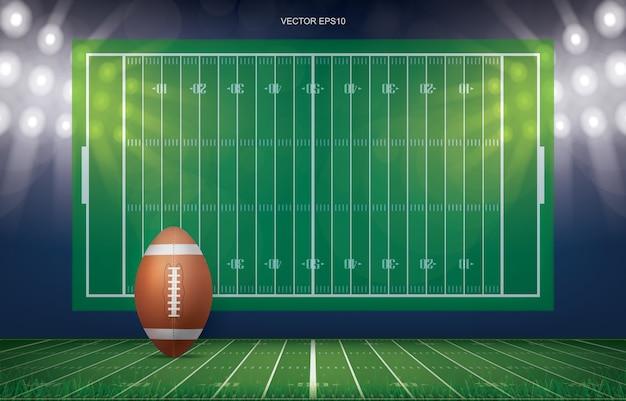 Football ball on football field stadium background