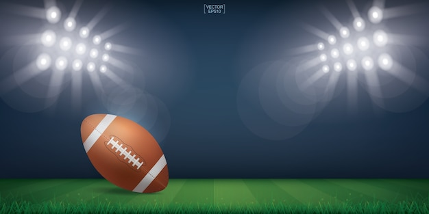 Football ball on green grass field.
