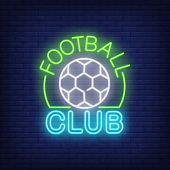 Football club neon sign. Soccer ball shape on brick wall background.