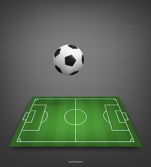 Football field or soccer field background with football ball