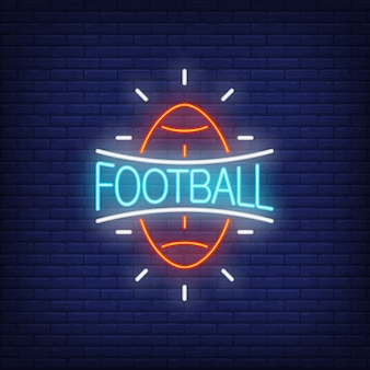 Football neon sign. Rugby ball shape on brick wall background.