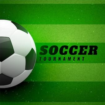 緑色の草のデザインの背景にサッカー