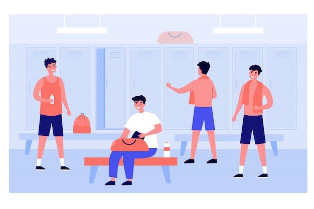 ロッカールームで変更するフットボールまたはサッカーチーム