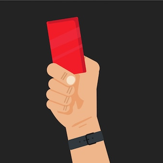 Football referee hand holding a red card