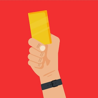Football referee hand holding a yellow card