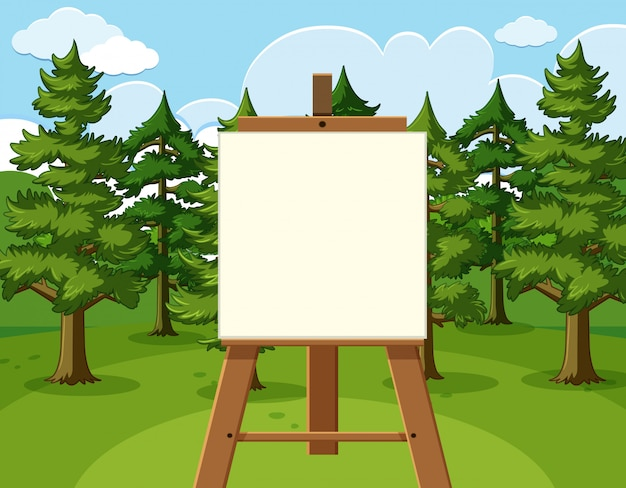 Forest scene with blank canvas in the field
