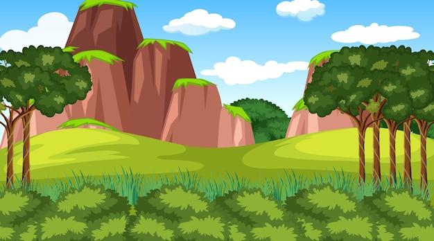 Scena della foresta con vari alberi della foresta e scogliera