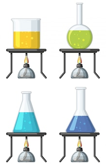 Four beakers with colorful liquid