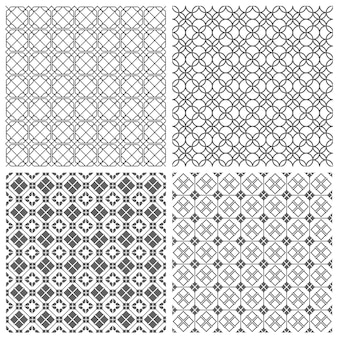Four geometric monochrome seamless tile patterns