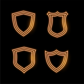Four golden neon shield icons