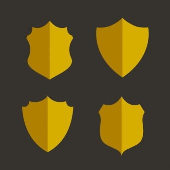 Four golden shields on a black background