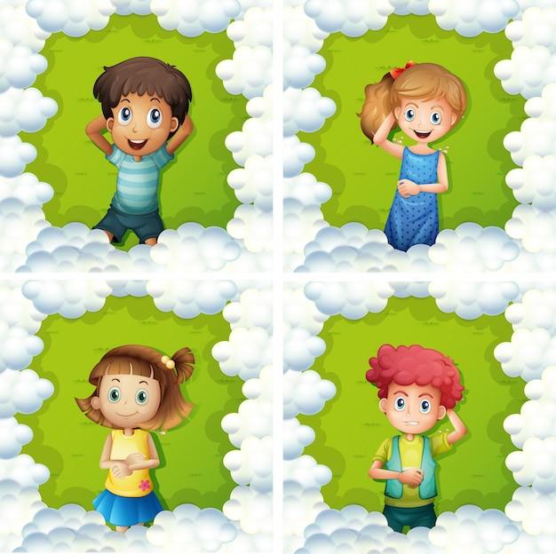 緑の草の上に4人の子供