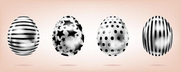 Четыре серебряные яйца на розовом фоне