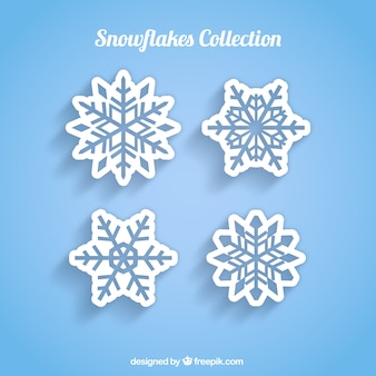 Four white snowflakes on a blue background