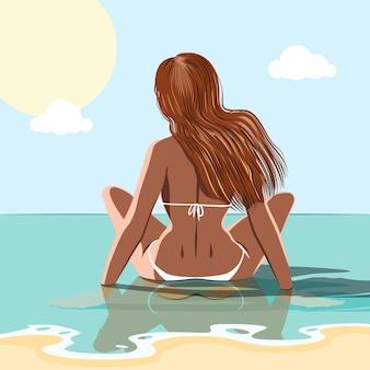 바다의 물에 앉아 폭시 소녀. 여름 개념