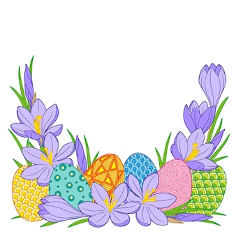 Frame of bright easter eggs and crocus flowers