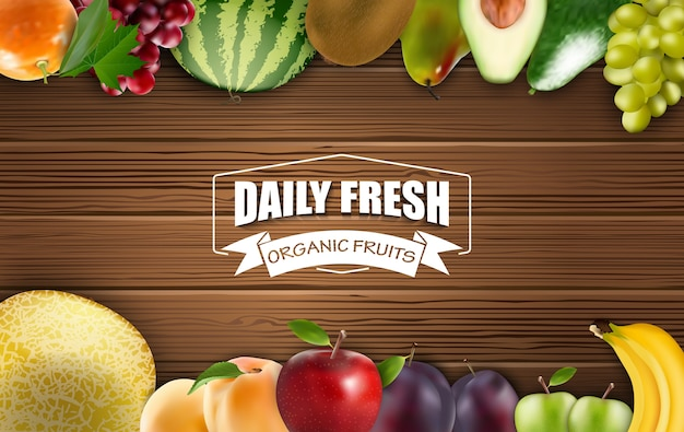 Frame of daily fresh organic fruits on a wooden background