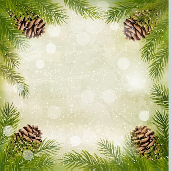Frame made of christmas tree branches with pine cones